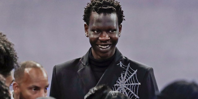 Oregon's Bol Bol smiles before the NBA Draft Thursday, June 20, 2019, in New York. (AP Photo/Julio Cortez)