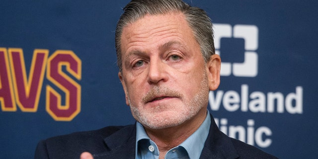 FILE - In this July 26, 2017, file photo, Cleveland Cavaliers owner Dan Gilbert answers a question during a news conference at the Cavaliers training facility in Independence, Ohio. Gilbert has been released from a Detroit-area hospital nearly a month after suffering a stroke. Quicken Loans president CEO Jay Farner says Gilbert was discharged Wednesday, June 19, 2019, from Beaumont Hospital in Royal Oak, Michigan.(AP Photo/Phil Long, File)