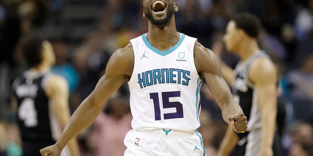 "The three-time All-Star point says he'd be willing to work with the Hornets and take less than the ""supermax"" $221 million contract he's eligible to receive to re-sign with Charlotte (AP Photo/Chuck Burton, File)"