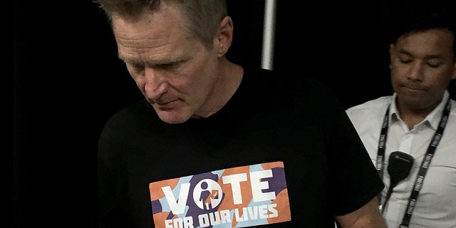 """Golden State Warriors head coach Steve Kerr wears a """"Vote for our Lives"""" shirt to a news conference before Game 2 of basketball's NBA Finals against the Toronto Raptors in Toronto, Sunday, June 2, 2019. (Neil Davidson/The Canadian Press via AP)"""