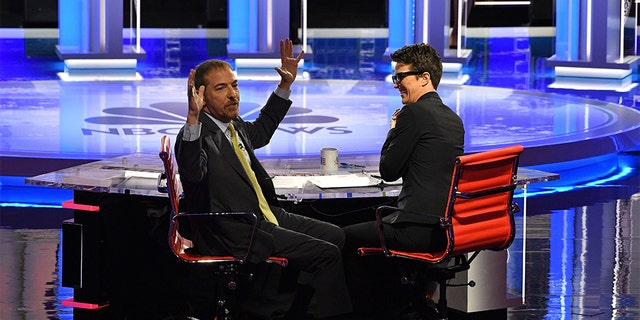 Moderators Chuck Todd (L) speaks to audience during a technical problem alongside Rachel Maddow. (JIM WATSON/AFP/Getty Images)