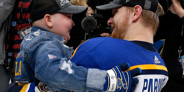 St. Louis Blues Colton Parayko lifts young fan Laila Anderson, left, while the team celebrated on the ice after the Blues defeated the Boston Bruins in Game 7 of the NHL Stanley Cup Final, Wednesday, June 12, 2019, in Boston. (AP Photo/Michael Dwyer)