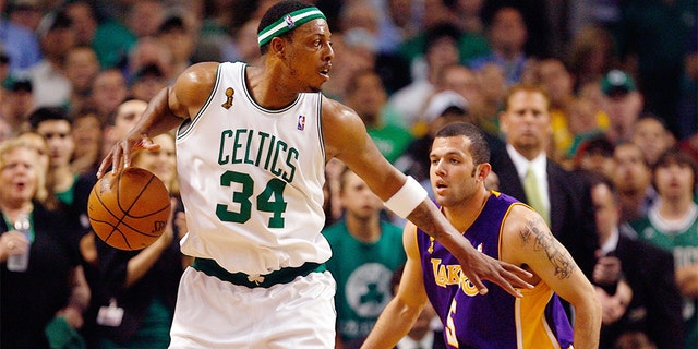 Paul Pierce, pictured playing for the Boston Celtics, led Kansas to the first two Big 12 titles. (Photo by Jim Rogash/Getty Images)