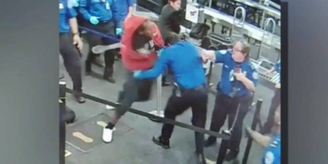 Footage taken at the Phoenix Sky Harbor International Airport shows the man bursting through the checkpoint.