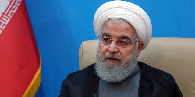 Iranian President Hassan Rouhani speaks if the US agrees to lift economic sanctions against Iran. (Iran Presidency through AP)