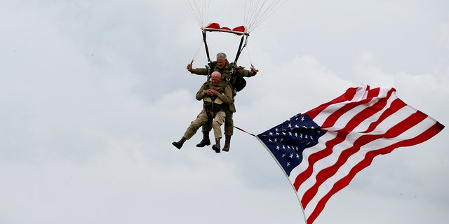 U.S. World War II paratrooper veteran Tom Rice, 97, in the commemorative parachute jump over Carentan on the Normandy coast on Wednesday.