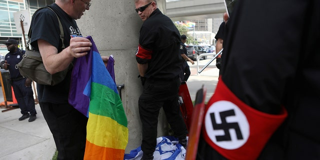 "A group of white nationalists marched on an LGBTQ event in Detroit on Saturday, demonstrating Nazi salutes and carrying weapons<br data-cke-eol=""1"">"