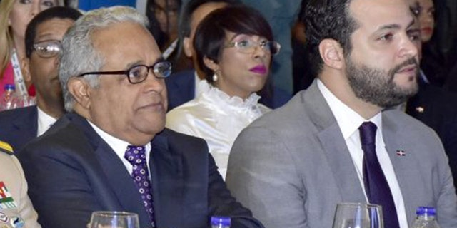 Dominican Republic Public Health Minister Rafael Sanchez Cardenas is seen on the left.