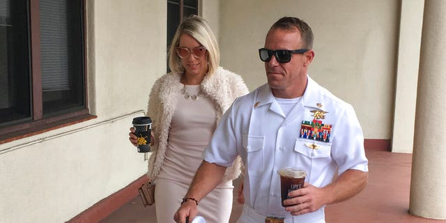 Navy Special Operations Chief Edward Gallagher, right, walks with his wife, Andrea Gallagher as they arrive to military court on Naval Base San Diego, Monday, June 24, 2019, in San Diego. (AP Photo/Julie Watson)