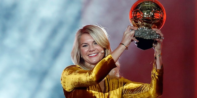 Ada Hegerberg celebrates with the Women's Ballon d'Or award during the Golden Ball award ceremony at the Grand Palais in Paris, France in 2018. (AP Photo/Christophe Ena, File)