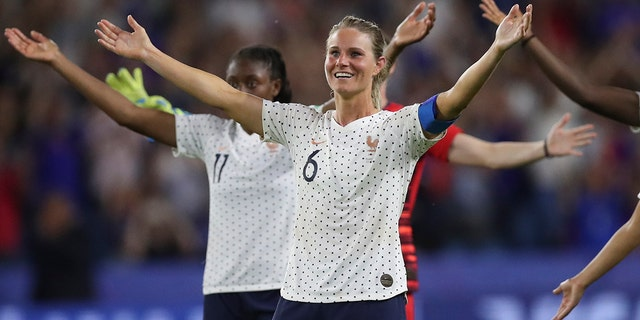 France's Amandine Henry celebrates at the end of the Women's World Cup round of 16 soccer match between France and Brazil at the Oceane stadium in Le Havre, France, Sunday, June 23, 2019. France beat Brazil 2-1. (AP Photo/Francisco Seco)