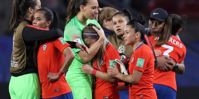 Chile players react at the end of the Women's World Cup Group F soccer match between Thailand and Chile at the Roazhon Park in Rennes, France, Thursday, June 20, 2019. Chile won 2-0, one goal short of the win by three goals difference needed to qualify for the next round. (AP Photo/David Vincent)