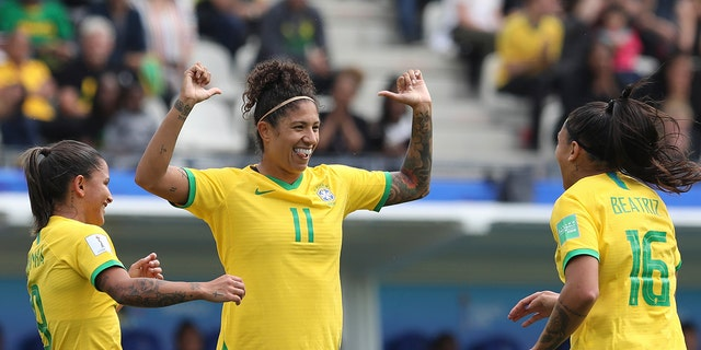 Brazil's Cristiane, center, celebrates after scoring her side's opening goal during the Women's World Cup Group C soccer match between Brazil and Jamaica in Grenoble, France, Sunday, June 9, 2019. (AP Photo/Laurent Cipriani)