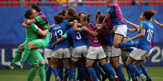 Players of Italy celebrate after winning the Women's World Cup Group C soccer match between Australia and Italy at the Stade du Hainaut in Valenciennes, Sunday, June 9, 2019. (AP Photo/Francisco Seco)