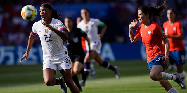United States' Jessica Mcdonald, left, runs after the ball next to Chile's Carla Guerrero during the Women's World Cup Group F soccer match between United States and Chile at Parc des Princes in Paris, France, Sunday, June 16, 2019. (AP Photo/Alessandra Tarantino)