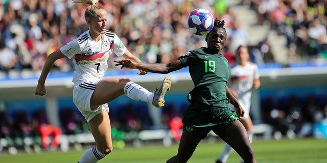 Germany's Lea Schueller, left, tussles for the ball with Nigeria's Chinwendu Ihezuo during the Women's World Cup round of 16 soccer match between Germany and Nigeria at Stade del Alpes in Grenoble, France, Saturday, June 22, 2019. Schueller scored once in Germany's 3-0 victory. (AP Photo/Laurent Cipriani)