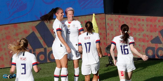 United States' Megan Rapinoe, center, celebrates with teammates after scoring her side's second goal from the penalty spot during the Women's World Cup round of 16 soccer match between Spain and United States at Stade Auguste-Delaune in Reims, France, Monday, June 24, 2019. (AP Photo/Thibault Camus)