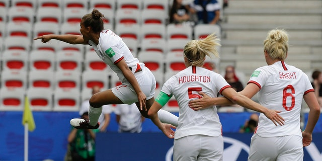 England's Nikita Parris, left, celebrates after scoring her side's opening goal on a penalty kick during the Women's World Cup Group D soccer match between England and Scotland in Nice, France, Sunday, June 9, 2019. (AP Photo/Claude Paris)