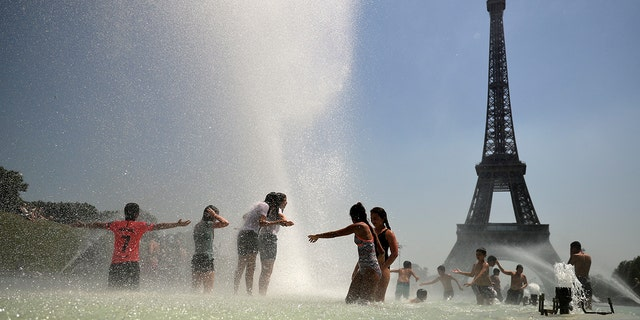 High temperatures are expected to go up to 102 Fahrenheit in the Paris area this week and bake much of the country, from the Pyrenees in the southwest to the German border in the northeast. (AP Photo/Francisco Seco)
