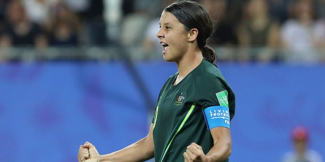 Australia's Sam Kerr celebrates after scoring her side's fourth goal during the Women's World Cup Group C soccer match between Jamaica and Australia at Stade des Alpes stadium in Grenoble, France, Tuesday, June 18, 2019. (AP Photo/Laurent Cipriani)