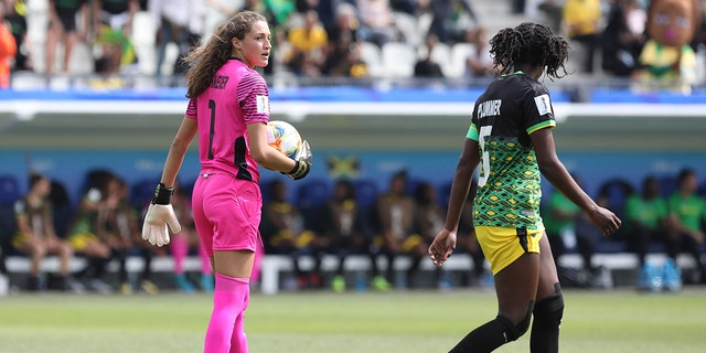 Jamaica goalkeeper Sydney Schneider, left, holds the ball during the Women's World Cup Group C soccer match between Brazil and Jamaica in Grenoble, France, Sunday, June 9, 2019. (AP Photo/Laurent Cipriani)