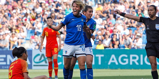 Italy's Valentina Giacinti, center, celebrates after scoring her side's first goal during the Women's World Cup round of 16 soccer match between Italy and China at Stade de la Mosson in Montpellier, France, Tuesday, June 25, 2019. (AP Photo/Claude Paris)