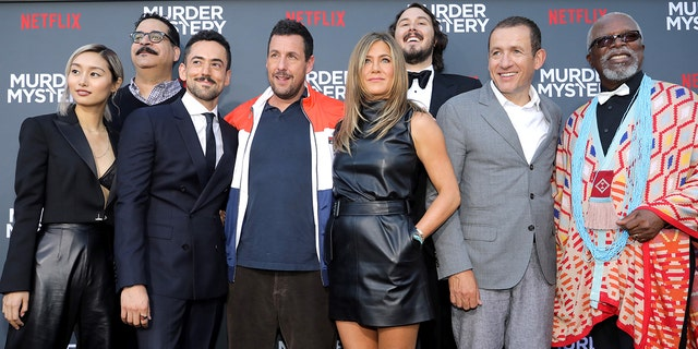 "(L-R) Shiori Kutsuna, Erik Griffin, Luis Gerardo Mendez, Adam Sandler, Jennifer Aniston, Kyle Newacheck, Dany Boon and Dr. John Kani attend the Netflix World Premiere of ""Murder Mystery"" at Village Theatre Westwood on June 10, 2019 in Los Angeles, Calif."