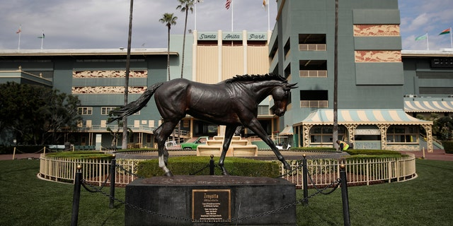 In this March 5, 2019, file photo, a statue of Zenyatta stands in the paddock gardens area at Santa Anita Park in Arcadia, Calif.