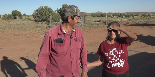 The Littlefoots in front of ther home on the vast Navajo Nation land.