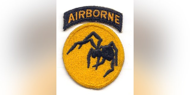 "Shoulder patch of the 135th Airborne Division, a non-existent ""ghost"" unit that was part of the First United States Army Group."