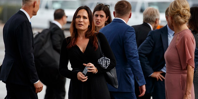 Stephanie Grisham, spokeswoman for first lady Melania Trump, stands at Orlando International Airport ahead of President Donald Trump's re-election kickoff rally at the Amway Center, Tuesday, June 18, 2019, in Orlando, Fla. (AP Photo/Evan Vucci)