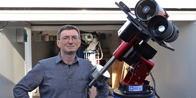 Professor Hakan Kayal next to the moon telescope. (Credit: Tobias Greiner / Universität Würzburg)
