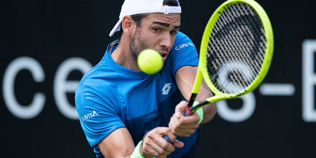 Italy's Matteo Berrettini returns the ball during his final match against Canada's Felix Auger-Aliassime at the ATP Tennis tournament in Stuttgart, Germany, June 16, 2019. (Silas Stein/dpa via AP)