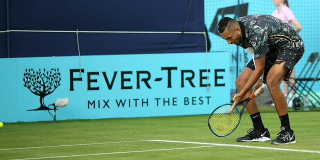 Australia's Nick Kyrgios appeals to the umpire on court one during his tennis match against Spain's Roberto Carballes Baena day four of the Fever-Tree Championship at the Queen's Club, London. (Steven Paston/PA via AP)