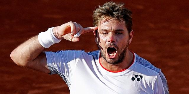 Switzerland's Stan Wawrinka won it all in 2015. (AP Photo/Christophe Ena )