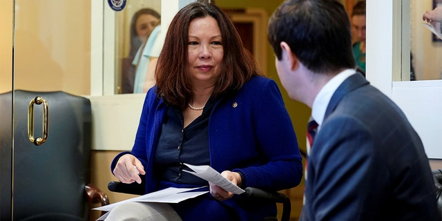 U.S. Senator Tammy Duckworth (D-IL) speaks with an aide before the announcement of the formation of the Senate Democrats' Special Committee on Climate Change on Capitol Hill in Washington, D.C., U.S., March 27, 2019. REUTERS/Joshua Roberts - RC152CDD3B80