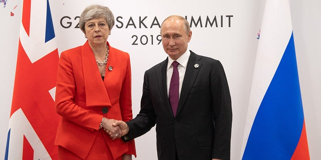 Britain's Prime Minister, Theresa May, offered an icy greeting to Russia's President, Vladimir Putin, during a bilateral meeting on the first day of the G20 summit Friday in Osaka, Japan. (Photo by Carl Court/Getty Images)