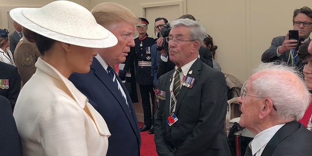 Melania Trump and US President Donald Trump meet veteran Thomas Cuthbert during commemorations for the 75th Anniversary of the D-Day landings at Southsea Common, Portsmouth.