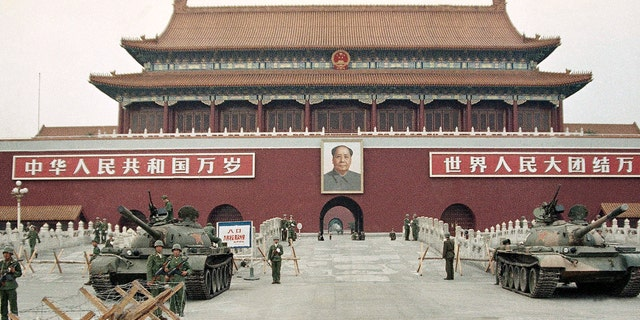 <br> People's Liberation Army troops stand guard with tanks in front of Tiananmen Square after crushing the students pro-democracy demonstrations in Beijing, June 10, 1989. (Associated Press)