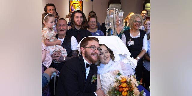 """Family joined staff to watch the couple say """"I do."""""""