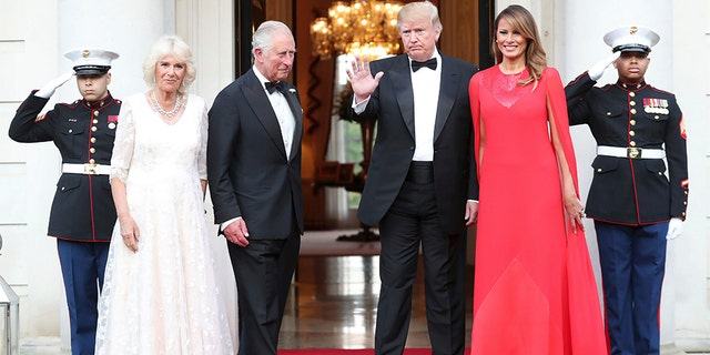 Donald Trump and first lady Melania Trump greet Britain's Prince Charles and Camilla, the Duchess of Cornwall, outside Winfield House, the residence of the Ambassador of the United States of America to the UK, in Regent's Park, prior to the Return Dinner as part of his state visit to the UK, in London, Tuesday June 4, 2019. (Chris Jackson/Pool Photo via AP)