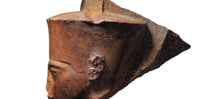 This image released by Christie's on Tuesday, June 11, 2019, shows a 3,000-year-old stone sculpture of the famed boy pharaoh Tutankhamun at Christie's in London. Egypt is trying to halt the auction of the sculpture of Tutankhamun at Christie's in London.