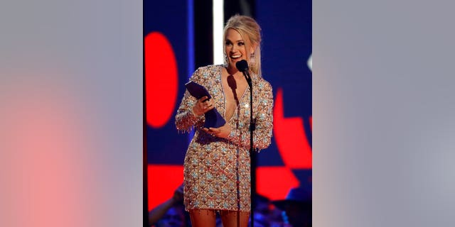 "Carrie Underwood accepts the award for female video of the year for ""Love Wins"" at the CMT Music Awards on Wednesday, June 5, 2019, at the Bridgestone Arena in Nashville, Tenn. (AP Photo/Mark Humphrey)"
