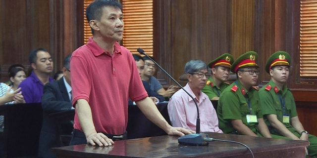 Michael Nguyen stands during his trial, Monday, June 24, 2019, in Ho Chin Minh City, Vietnam.