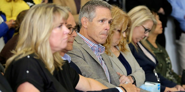 John Van Cuylenborg, center, surrounded by family and friends await the verdict of William Talbott II, Friday, June 28, 2019, at the Snohomish County Courthouse in Everett, Wash. Talbott was found guilty in the 1987 killings of Jay Cook and Tanya Van Cuylenborg, a young Canadian couple. (Kevin Clark/The Herald via AP, Pool)