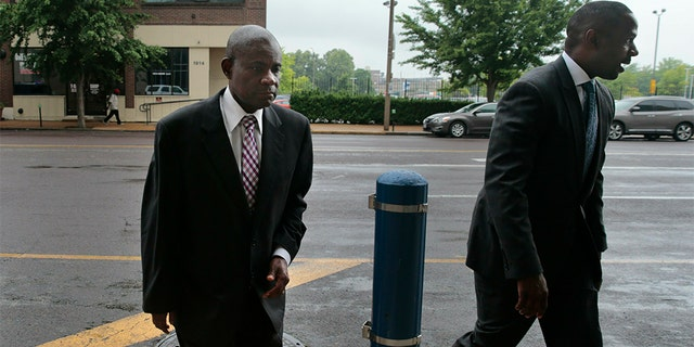 Former FBI agent William Don Tisaby, left, accompanied by attorney Jermaine Wooten, as he turned himself in at St. Louis Police headquarters on Monday.