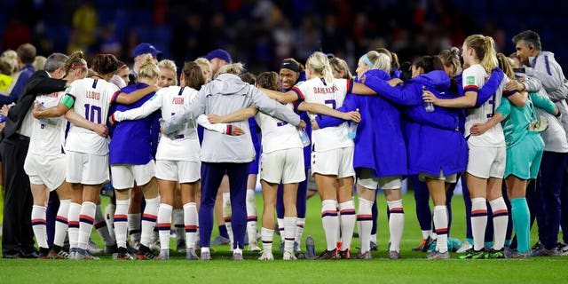 US players embrace following their 2-0 win over Sweden in their Women's World Cup Group F soccer match at Stade Océane, in Le Havre, France, Thursday, June 20, 2019. (AP Photo/Alessandra Tarantino)
