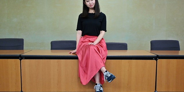 Yumi Ishikawa, leader and founder of KuToo movement, posed after a press conference in Tokyo on June 3, 2019 (Photo by Charly TRIBALLEAU / AFP)