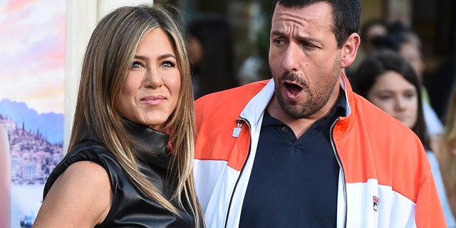 Cast members Jennifer Aniston and Adam Sandler arrive during a Los Angeles premiere of Murder Mystery during a Regency Village Theatre on Monday, Jun 10, 2019 in Westwood, Calif. (Photo by Jordan Strauss/Invision/AP)