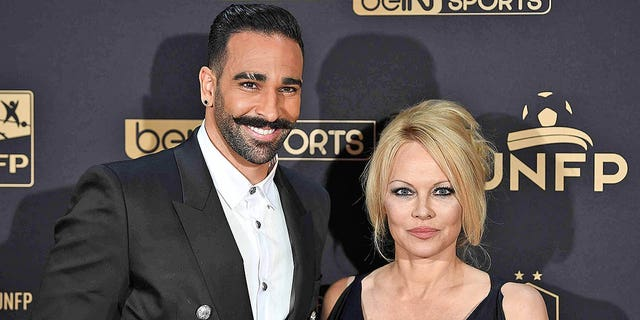 Marseille's defender Adil Rami and actress Pamela Anderson arrive to take part in a TV show on May 19, 2019 in Paris, as part of the 28th edition of the UNFP (French National Professional Football players Union) trophy ceremony. They split a month later.